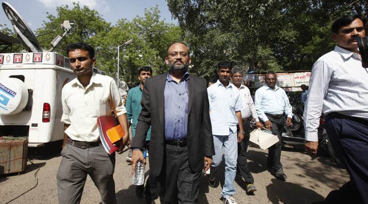 Former IAS officer, Sanjay Gupta (in suit), who has been arrested in connection with the alleged irregularities of Rs 113 crores in the Ahmedabad-Gandhinagar Metro Rail project by Gujarat CID (Crime), was produced in the court in Ahmedabad, on Friday. Gupta was executive chairman of Metro-link Express for Gandhinagar and Ahmedabad (MEGA) Company Ltd which is executing the project. (Express photo by Javed Raja)