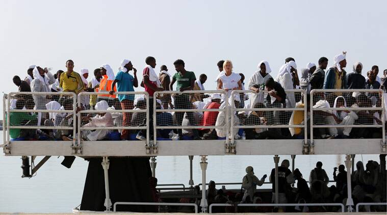 Migrants wait to disembark from the ' The Phoenix ' a Malta-based Migrant Offshore Aid Station, in the Sicilian harbor of Pozzallo, Italy, Tuesday May 5, 2015. More than 350 migrants were on the Maltese-registered ship that brought them to safety, according to Doctors Without Borders who are helping with the rescue effort. (AP Photo/Francesco Malavolta)