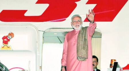 PM Narendra Modi leaves for a tour of China, Mongolia and South Korea, in New Delhi on Wednesday.  (Source: PTI photo)