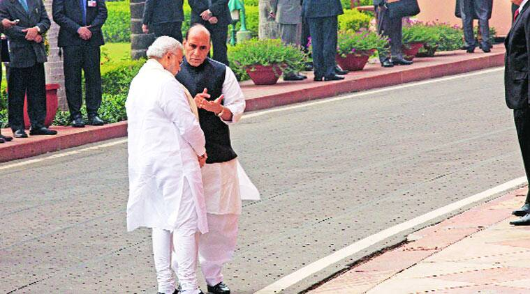 PM and Rajnath Singh in discussion in Parliament. (Source: Express photo by Neeraj Priyadarshi)