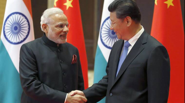 Prime Minister Narendra Modi, left, and Chinese President Xi Jinping shake hands prior to their meeting in Xian, Shaanxi province, China, Thursday, May 14, 2015. (Source: AP)