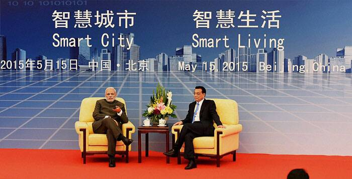 Narendra Modi, Modi China visit, Modi visits China, Li Keqiang, Modi Li Keqiang, Modi meets Li Keqiang, India-China Forum, Modi Beijing, Modi China visit, World news