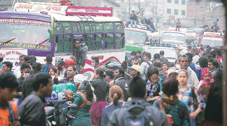 Every day, people flee Kathmandu in buses that take them to other places in Nepal or to Gorakhpur on the Indian side. (Source: Express photo by Vishal Srivastav)