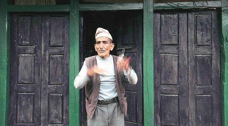 """Chim Bahadur Gurung, an ex-Indian Army soldier, says he has been promised help. """"The police came on Wednesday and took some photographs of my house that was damaged. They said they would do something,"""" he says. (Source: Express photo by Vishal Srivastav)"""