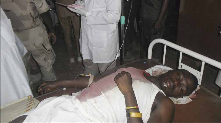 A student wounded during a suicide bomb attack at the College of Administrative and Business Studies  receives treatment at a hospital in Potiskum  Nigeria Friday, May 8, 2015. Suspected Boko Haram extremists attacked a business school in northeast Nigeria on Friday with gunfire and two bomb blasts. A suicide bomber died when he blew himself up prematurely in the car park of the College of Administrative and Business Studies in Potiskum, according to a security officer and a hospital worker.  (AP Photo/Adamu Adamu)