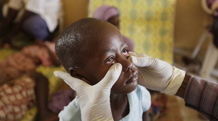 A doctor examines a child rescued by Nigerian soldiers from Boko Haram extremists at a refugee camp in Yola, Nigeria Sunday, May 3, 2015, after being rescued from captivity by Boko Haram fighters. Their faces were gaunt with signs of malnutrition but the girls are alive and free, among a group of 275 children and women rescued by the Nigerian military, and the first to arrive at a refugee camp Saturday after a three-day journey to safety. They came from the Sambisa Forest, thought to be the last stronghold of the Islamic extremists, where the Nigerian military said it has rescued more than 677 girls and women and destroyed more than a dozen insurgent camps in the past week. ( AP Photo/Sunday Alamba)