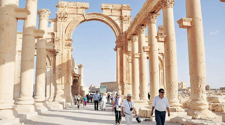 Tourists walk in the historical city of Palmyra, September 30, 2010. Islamic State fighters in Syria have entered the ancient ruins of Palmyra after taking complete control of the central city, but there are no reports so far of any destruction of antiquities, a group monitoring the war said on May 21, 2015. Picture taken September 30, 2010. REUTERS/Nour Fourat
