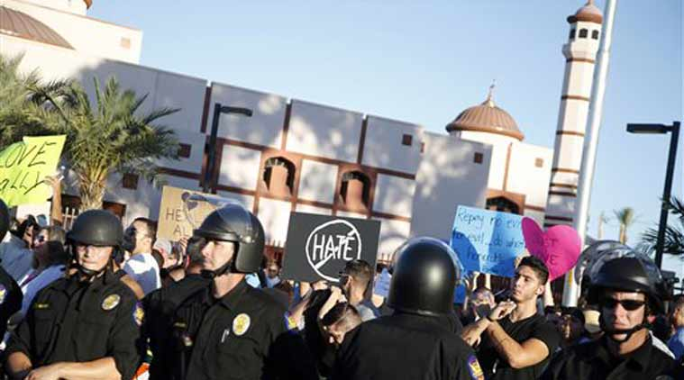 Protesters gather outside the Islamic Community Center of Phoenix, Friday. (Source: AP photo)
