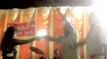 Watch: Two Gujarat cops dance with a woman, shower money while on duty