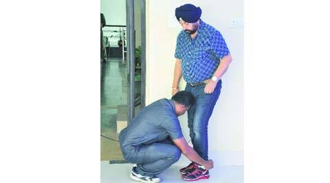 Plannig minister, Rachpal Singh, Nabanna, shoe lace controversy, minister shoe lace, guard tying minister's shoe lace, kolkata news, city news, local news, Bengal news, Indian Express