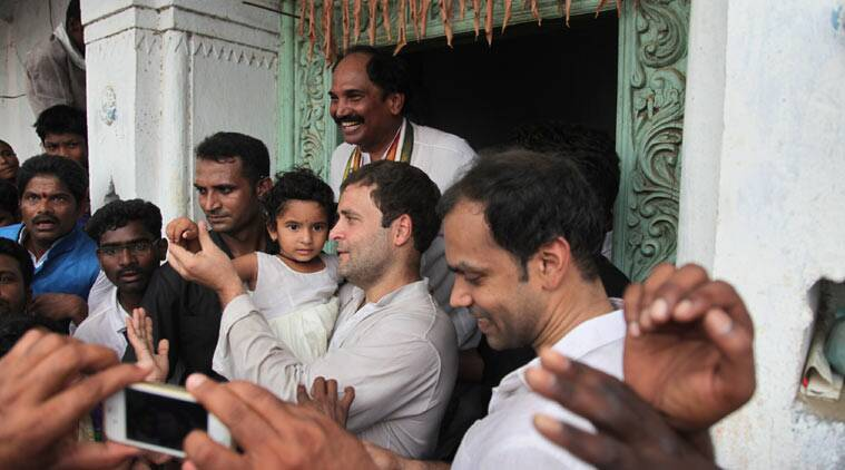 Rahul Gandhi with the  little daughter of a farmer who committed suicide, in Lakshmanchanda village, Nirmal, Adilabad district. (Source: Express photo by
