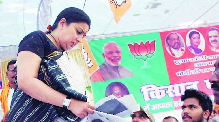 HRD Minister Smriti Irani meets farmers at a public meeting in Amethi on Tuesday. (Source: PTI photo)