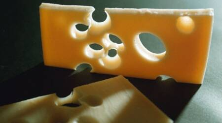 Mystery of disappearing holes in Swiss cheese solved