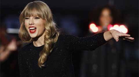 Taylor swift, taylor swift being pop star, taylor swift black space, taylor swift singer, taylor swift pop artist, taylor swift music awards, taylor swift songs, taylor swift album, taylor swift videos, taylor swift hit songs, taylor swift top songs, taylor swift pop songs, taylor swift download songs, taylor swift singing career, hollywood, entertainment news