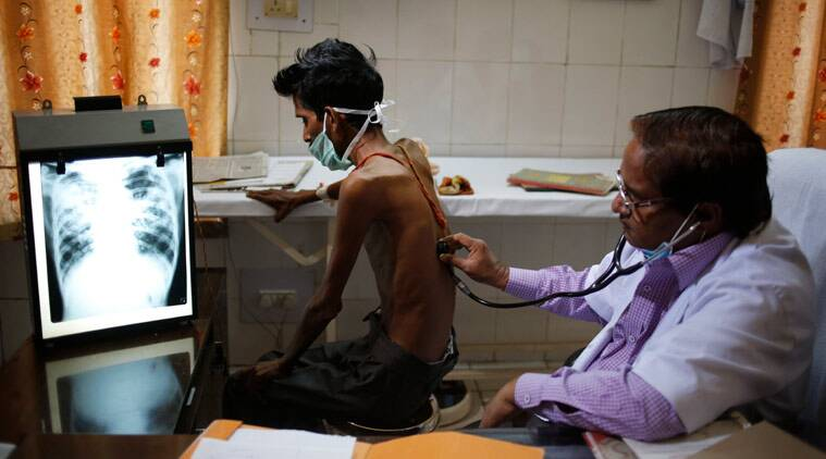 An Indian doctor examines a tuberculosis patient in a government TB hospital. (Source: AP Photo)