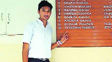 Tejaswin Shankar, who won bronze in high jump at Asian Youth C'ships, points to his name on the roll of honour at his school.