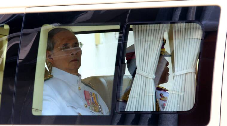Thai King Bhumibol Adulyadej, left, and Thai Crown Prince Vajiralongkorn, right, leave Siriraj Hospital in Bangkok, Tuesday, May 5, 2015. Thailand's revered King Bhumibol Adulyadej made a rare public appearance Tuesday to mark the 65th anniversary of his coronation. (Phamorn Manapornchai/Daily News via AP)