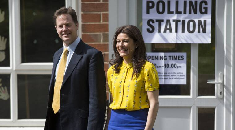 Liberal Democrat Party leader Nick Clegg and his wife Miriam Gonzalez Durantez leave the the Hall Park Centre after voting in Sheffield, England, Thursday May 7, 2015, as Britain takes to the polls in a General Election. Polls opened in Britain's national political election Thursday, with opinion polls widely predicting an uncertain outcome. (AP Photo/Jon Super)