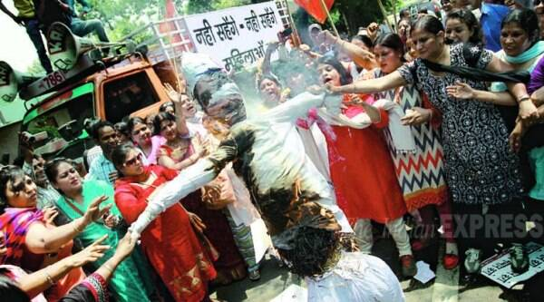 Activists of BJP Mahila Morcha burns effigy of AAP Leader Kumar Vishwas near Arvind Kejriwal residence in New Delhi on Tuesday.  (EXPRESS PHOTO BY PRAVEEN KHANNA) Activists of BJP Mahila Morcha burns effigy of AAP Leader Kumar Vishwas near Arvind Kejriwal residence in New Delhi on Tuesday. (EXPRESS PHOTO BY PRAVEEN KHANNA)
