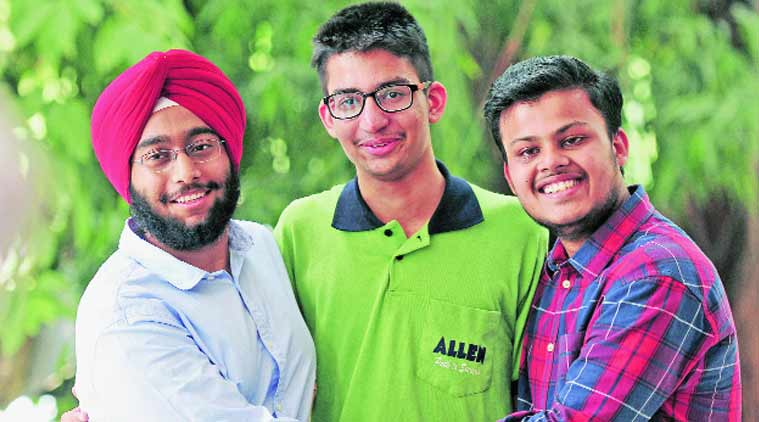 City toppers Agamjit Singh, Yuvraj Chopra and Madhav Bansal after the declaration of results on Thursday in Chandigarh. (Source: Express photo by Kamleshwar Singh)