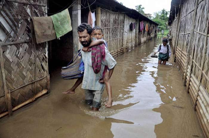 Assam flood, Assam floods, Assam monsoon, Assam monsoon flood, Brahmaputra overflowing, Assam Brahmaputra floods, Arunachal Pradesh floods, Brahmaputra tributaries floods, Assam flood affected districts, Assam MeT department, Assam Barpeta, Lakhimpur, Dhemaji floods, Assam flood news, Assam Flood photos, arunachal flood photos, Brahmaputra flood photos, india news, assam news, northeast news,