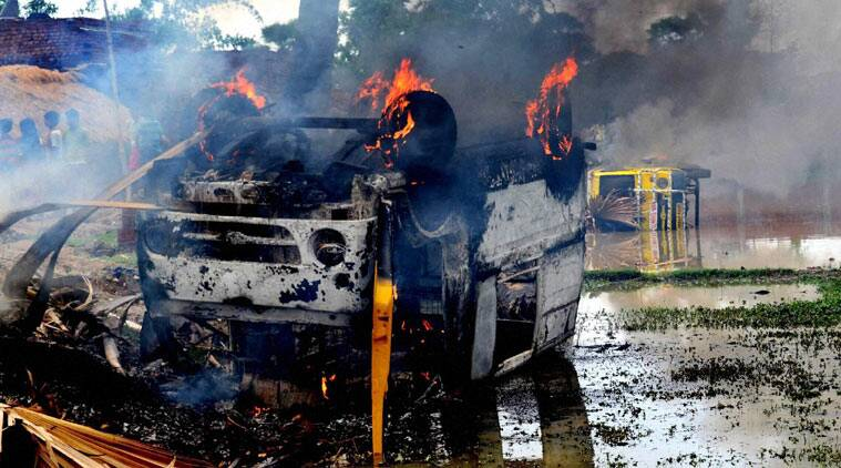 Local protesters torched two school vans following recovery of the bodies of two students of a residential public school located near Nirpur village in Bihar's Nalanda district on Sunday. (Source: PTI photo)