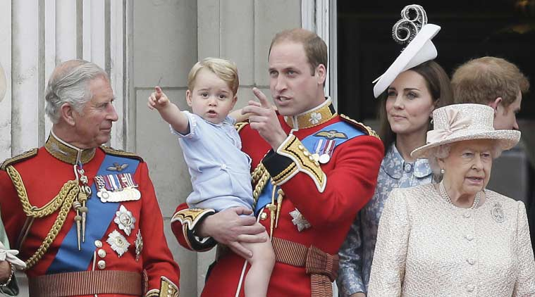 Britain's Prince William holds his son Prince George, with Queen Elizabeth II, right, Kate, Duchess of Cambridge and the Prince of Wales during the Trooping The Colour parade at Buckingham Palace, in London. (Source: Associated Press)