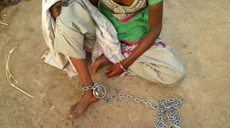 chain, woman tied with chain, vadodara, crime news,