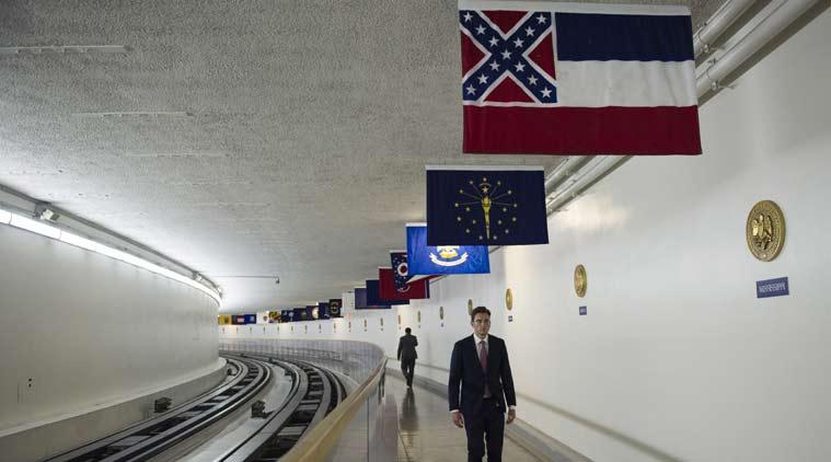 The Mississippi flag hangs, with the other 49 state flags, in the subway between the U.S. Capitol and Dirksen Senate Office Building in Washington. (Source: AP)