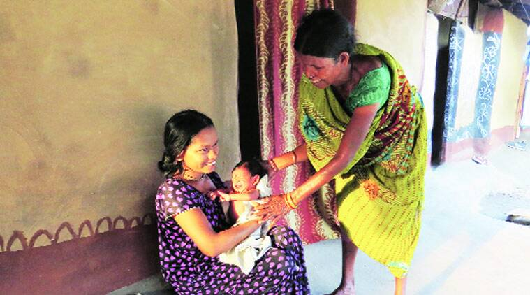 Vetti Meena with her newborn in a camp in Dornapal — wife of an SPO, she grieves that they can never leave. (Source: Express photo by Ashutosh Bhardwaj)