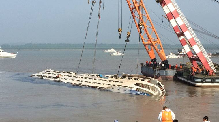 Cranes attempt to lift the capsized tourist ship Eastern Star in Jianli county in southern China's Hubei province Friday, June 5, 2015.