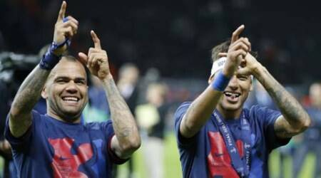 Barcelona's Dani Alves and Neymar celebrate after the Champions League final soccer match between Juventus Turin and FC Barcelona at the Olympic stadium in Berlin Saturday, June 6, 2015. Barcelona won the match 3-1.  (AP Photo/Frank Augstein)