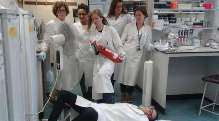 DistractinglySexy is the response to Nobel prize winner Tim Hunt's sexist remarks. Women posing in a cancer research lab. (Source: @_feeohna from Twitter)
