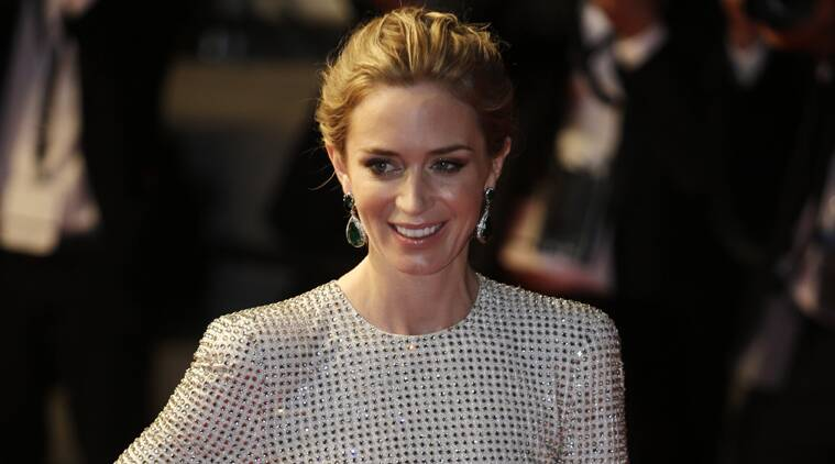 Actress Emily Blunt poses for photographers as she leaves following the screening of the film Sicario at the 68th international film festival, Cannes, southern France, Tuesday, May 19, 2015. (AP Photo)