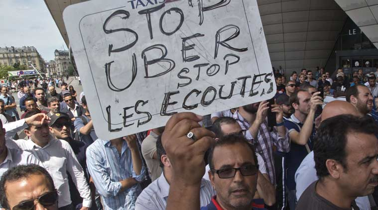 angry french taxi drivers smash cars in strike against uber the indian express. Black Bedroom Furniture Sets. Home Design Ideas