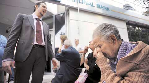 Greece, greece bailout. imf, greece imf bailout, greece debt. greek debt, greek default, greek imf default, greece imf default, Greece banks, Greece banks closure, Greece protests, Greece economy, Greece ATM limits, Greece limits withdrawals, Greece ATM withdrawals, Greece banks shut, European central bank, Greece loans, economy Greece, europe news, economy news, world news, indian express news