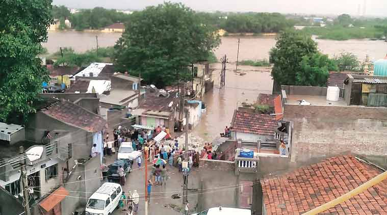 flash flood, gujarat govt, relief package, congress, BJP, ahmedabad news, city news, local news, Gujarat news, Indian Express