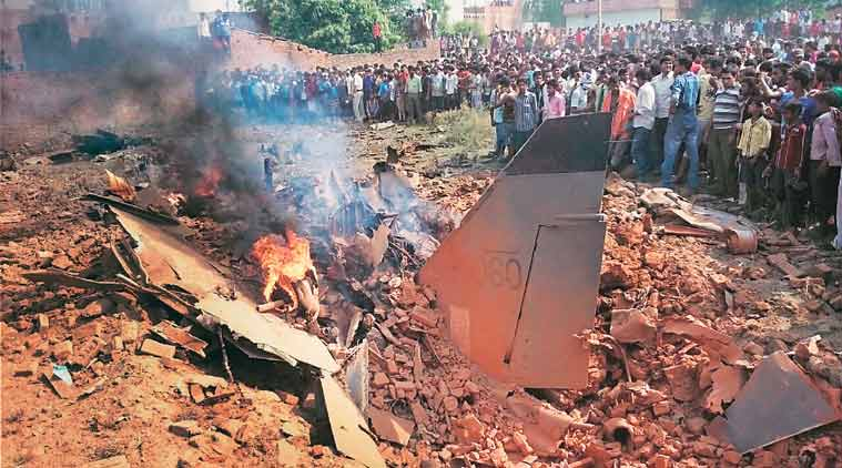 People look at the wreckage of a Jaguar aircraft that crashed at Chaka village, near Allahabad, on Tuesday. (Source: PTI)