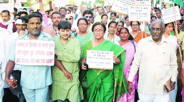 Congress members led by Rita Bahuguna Joshi hold a peace march demanding arrest of minister Ram Murti Verma in Shahjahanpur journalist Jagendra Singh's  death, in Lucknow on Monday. (Source: Express photo by Vishal Srivastav)
