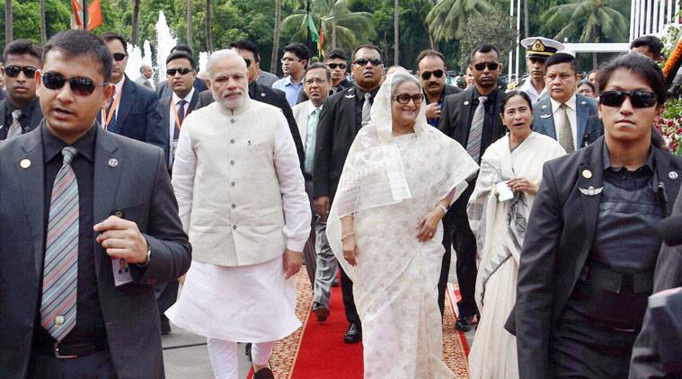 narendra modi bangladesh visit, narendra modi dhaka visit, Land Boundary Agreement, india bangladesh Land Boundary Agreement, india bangladesh LBA, Narendra Modi mamata banerjee Bangladesh visit, Bangladesh Narendra Modi mamata banerjee, narendra Modi bangladesh, Modi Bangladesh visit, Modi Bangladesh news, Modi news, Modi posters Bangladesh
