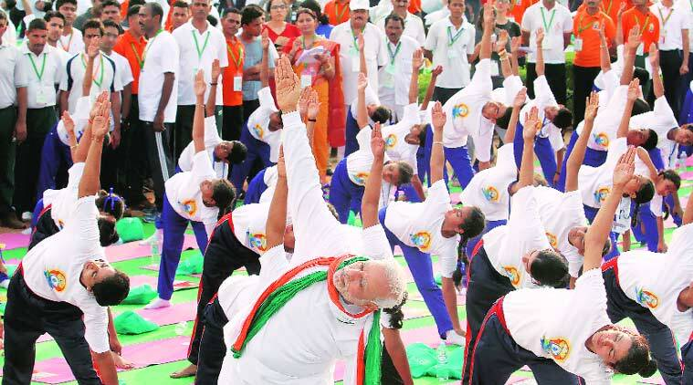 Prime Minister Narendra Modi performs one of several asanas at Rajpath on Sunday. (Source: Express photo by Ravi Kanojia)