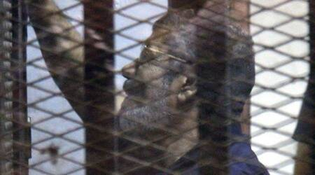 Egypt arrests 2 top Islamists, sets date for Mohammed Morsi sentence