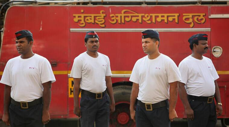 A typical day at the Byculla Fire Station begins with the first shift at 7 am. Upon assembly, fire personnel conduct a parade, marking attendance, and going through various drills – operating the water hose, climbing up a specially constructed tower to practice working on heights. These drills are put into practice each time an engine is sent to respond to a fire call. In the aftermath of the Kalbadevi fire, the mood is slightly glum as evidenced with a number of pictures put up of slain fire fighter Manohar Desai put up at a number of places inside the fire station, where he had a cabin on the ground floor. (Source: Express photo by Prashant Nadkar)