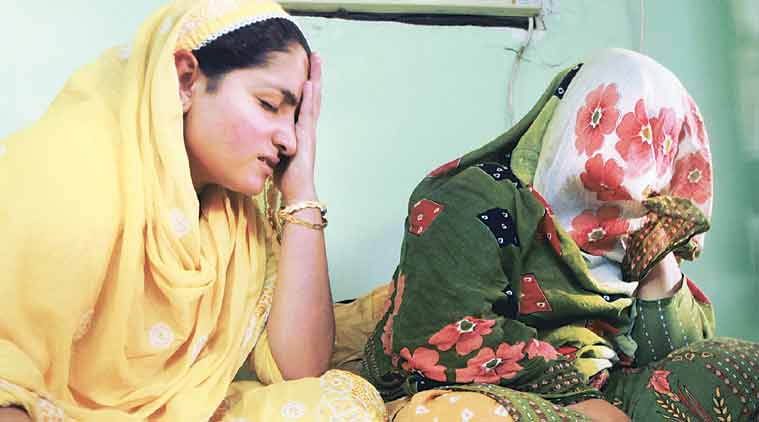 A grieving Nilofer and her mother. (Source: Express Photo by Kevin DSouza)