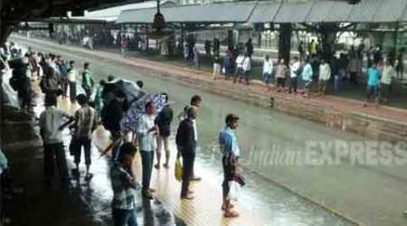 Mumbai rains: Thousands of commuters stranded as local train servicesdisrupted
