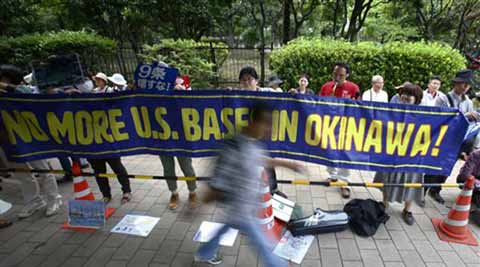 Japan says temporarily halting work on new US base in Okinawa