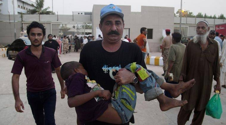 A Pakistani man rushes a child suffering from heatstroke to a hospital in Karachi, Pakistan, Tuesday, June 23, 2015. A scorching heat wave across the southern city has killed hundreds of people, authorities said Tuesday. The heat wave compounded the struggles of ordinary Pakistanis as it struck amid the holy, fasting month of Ramadan, when observant Muslims abstain from food or water during daylight hours. (AP Photo/Shakil Adil)