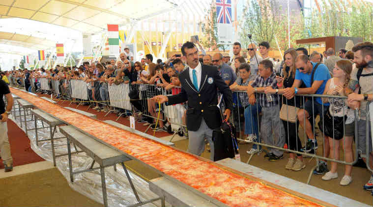 Pizza, World's longest pizza, World record, Guinness World Record Pizza, Pizza  in Milan, Longest pizza in Milan, Social Media, Viral