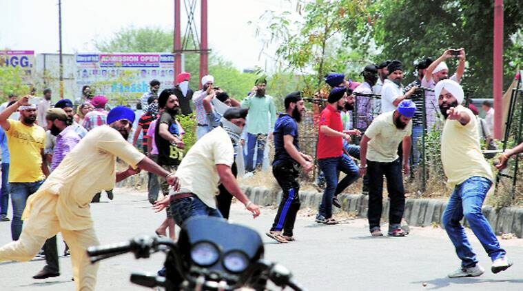 Protesters pelt stones at police in Jammu on Wednesday.  (Source: PTI photo)