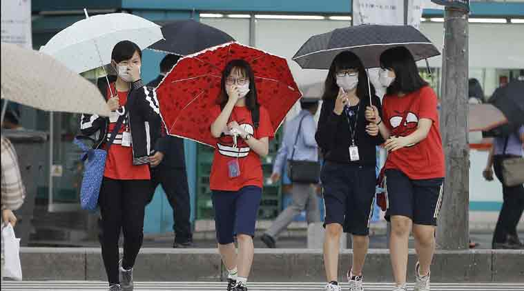 South Korean middle school students wear masks as a precaution against the MERS, Middle East Respiratory Syndrome, virus as they go to school in Seoul, South Korea, Friday, June 5, 2015. (AP Photo)